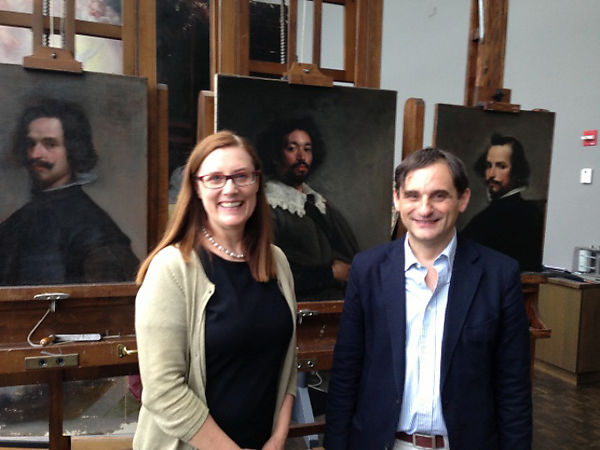 """Dorothy Mahon and Javier Portús, standing in the Department of Paintings Conservation, June 2014. On the easels left to right: """"Portrait of a Man"""" (The Met, 49.7.42); """"Juan de Pareja"""" (The Met, 1971.86); and """"Portrait of a Man"""" (The Met, 89.15.29)."""